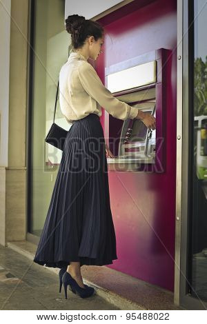 Elegant woman doing a withdrawal