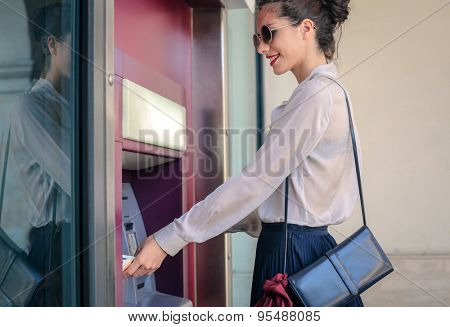 Woman doing a withdrawal at the bank