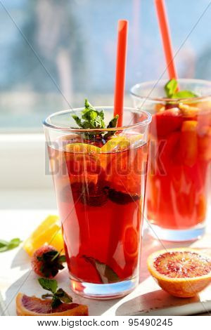 Summer. Refreshing drink by the window
