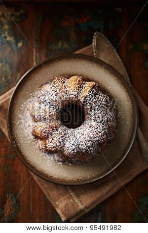 Marble cake with icing sugar on a plate