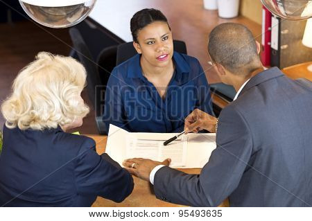 High angle view of businesspeople talking to receptionist in office