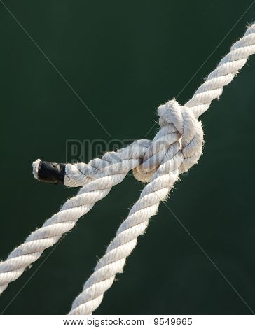 Tight Knot On A White Rope