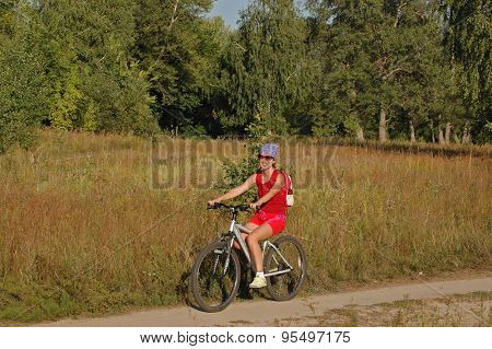 Woman riding a bicycle in countryside
