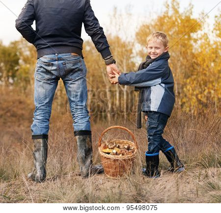 Smiling Little Boy With His Father On The Mushrooms Picking