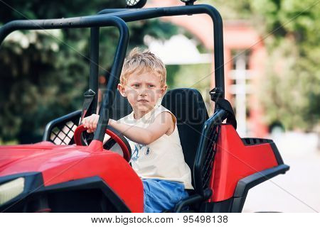 Boy Drive A Toy Electric Car