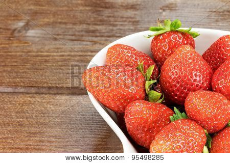Bowl With Strawberries  On The Wooden Table
