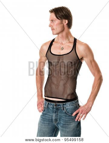Man in mesh tank top and jeans. Studio shot over white.