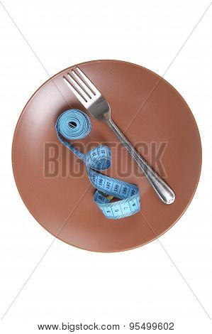 Measuring Tape And Fork On A Plate