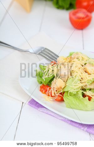Caesar Salad In A White Plate