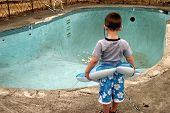 Little Boy And An Empty Pool