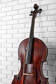 foto of cello  - Cello on bricks wall background - JPG