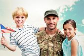 foto of reunited  - Soldier reunited with his children against blue sky - JPG