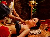 picture of panchakarma  - Young woman having neck Ayurveda spa treatment - JPG