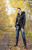 picture of woman boots  - woman wearing rubber boots in autumnal nature - JPG