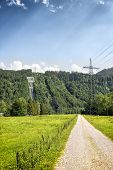 pic of hydroelectric  - View to tubes of a hydroelectric power plant on the hill with trees on Lake Kochelsee Bavaria Germany - JPG