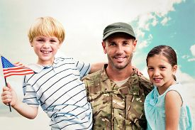 pic of reunited  - Soldier reunited with his children against blue sky - JPG