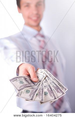 man stretches money