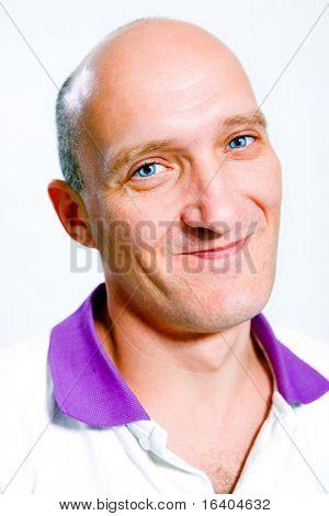 Portrait bald men happy smiles. Blue eyes