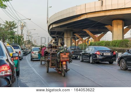 Tricycle And Car At Intersection Traffic Light