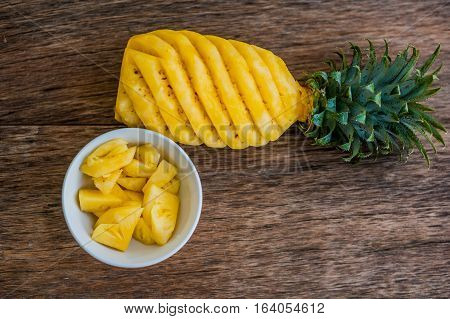 Pineapple Slices And Pineapple Shelled On The Old Wooden Background