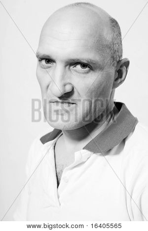 Portrait of the man indignation. Bald