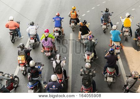 Motorcycle At Intersection With Traffic Light