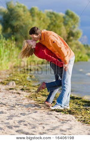 Young love Couple kissed on bank of river.