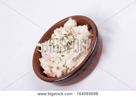 photo of pot of coleslaw isolated on a white background