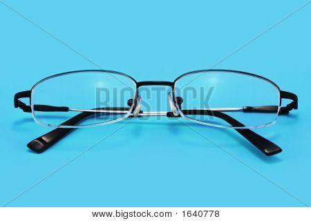 Eyeglasses (Isolated On Blue)