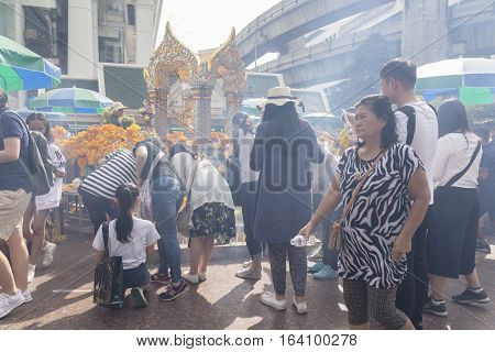 BANGKOKTHAILAND - DEC 31 : incense smoke scene from people worship in Erawan shrine while new year festival on december 31 2016 Thailand. Erawan shrine is famously place in ratchaprasong area