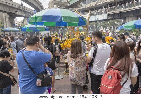 BANGKOKTHAILAND - DEC 31 : scene of Unidentified people worship in Erawan shrine in ratchaprasong area while new year festival on december 31 2016 Thailand. Erawan shrine is famous place for tourist