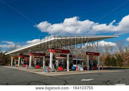 Absecon NJ December 10 2016: A Wawa gas station on New Jersey route 30. Wawa Inc is a chain of convenience store/gas stations located along the East Coast of the United States.