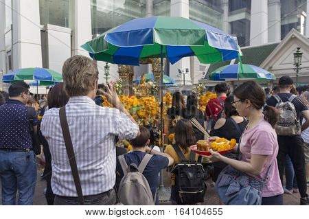BANGKOKTHAILAND - DEC 31 : Unidentified person pray at Erawan shrine in ratchaprasong area on december 31 2016 Thailand. there are many tourist worship at Erawan shrine in new year festival