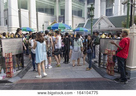 BANGKOKTHAILAND - DEC 31 : view of crowd in Erawan shrine from gate while new year festival on december 31 2016 Thailand. Erawan shrine is famously sacred place in bangkok