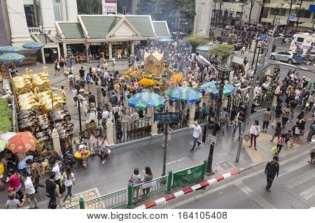 BANGKOKTHAILAND - DEC 31 : scene of massive crowd in Erawan shrine at Ratchaprasong Junction while new year festival on december 31 2016 Thailand.