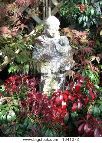 Attractive Statute Surrounded By Foliage