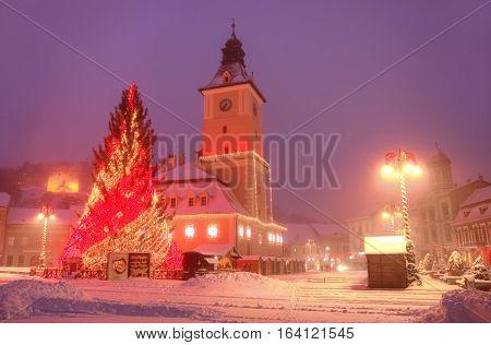 Beautiful winter postcard from Brasov, city of Transylvania in Christmas season, Romania