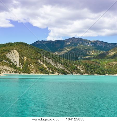 Wooded Shore of the Lake in French Alps