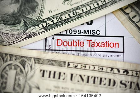 Double taxation agreement concept, with form and US dollar bills