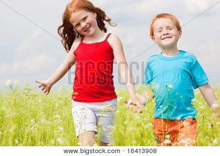 Two fan children playing on the field