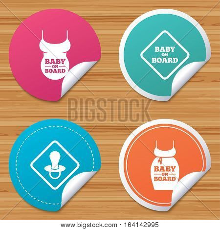 Round stickers or website banners. Baby on board icons. Infant caution signs. Child pacifier nipple. Pregnant woman dress with big belly. Circle badges with bended corner. Vector
