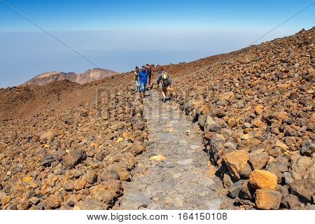 El Teide Tenerife June 06 2015: Unidentified tourists are walking on the top of El Teide Volcano Tenerife Spain