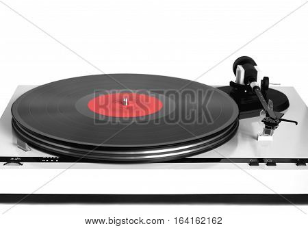Modern turntable in silver case with rotation vinyl record with red label isolated on white background. Horizontal photo front view closeup