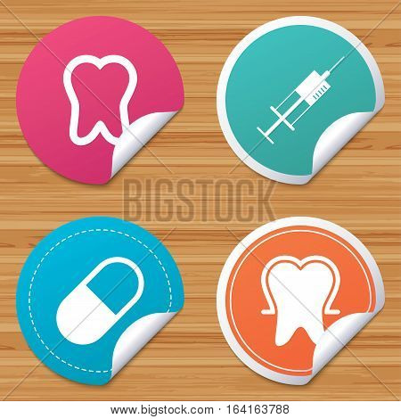 Round stickers or website banners. Tooth enamel protection icons. Medical syringe and pill signs. Medicine injection symbol. Circle badges with bended corner. Vector