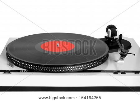 Turntable in gray case with black vinyl record with red label on disc with stroboscope marks isolated on white background. Horizontal black and white photo front view closeup
