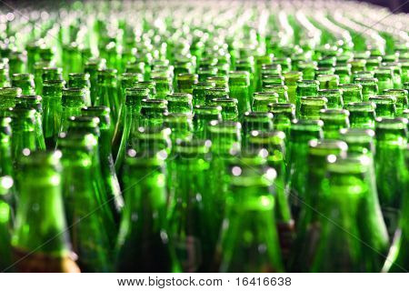 Bunch of green glass bottles. Soft focus.