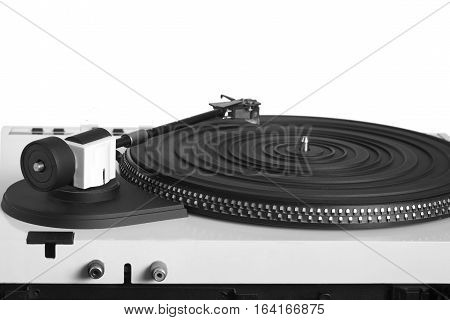 Turntable with right tonearm in silver case with rubber mat on black disc with stroboscope marks with output connectors rear view isolated on white background. Horizontal view closeup