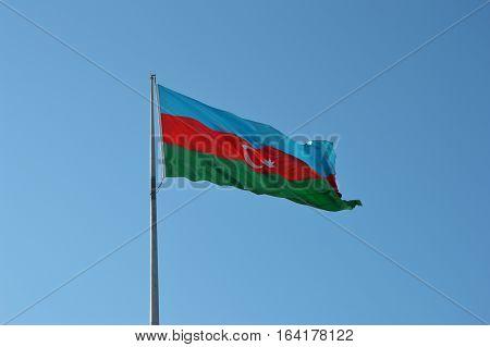 Azerbaijan flag against the clear blue sky