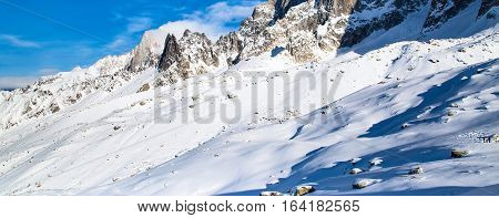Panorama of white snow mountain landscape and blue sky in french alps