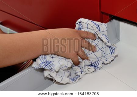Person wipes a drawer cleanly with cleaning rags